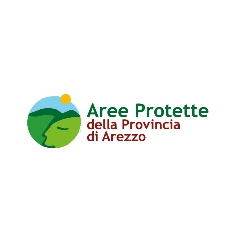 Logo delle Aree Protette della Provincia di Arezzo. L'idea per la realizzazione di questo logo mi è venuta pensando alla natura che si sente tranquilla perché protetta. Ho usato montagne e colline tracciando un profilo umanizzato pacifico e rilassato.